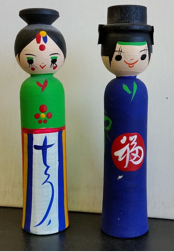 Asian handpainted wooden dolls. VG. Both for $15